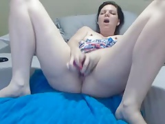 Horny slut pounds pussy with dildo (NS)