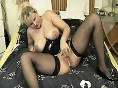 Huge breasted blonde milf in black lingerie makes her tight