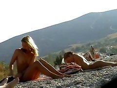 Sexy sweethearts caught on the nudist beach