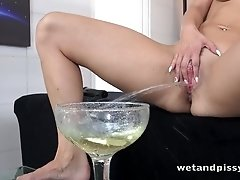 Nasty pissing chick Bianca Ferrero is dildo fucking her wet pussy