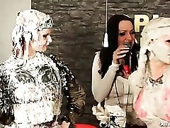 Getting messy and muddy with three well dressed women