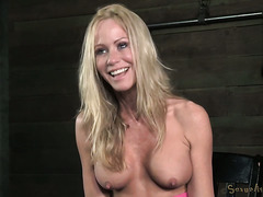 Topless blond milf Simone Sonay is interviewed after hardcore bdsm scene
