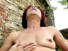 Mom in the garden fingering her pink cunt