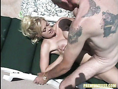 Busty whore Brooke Hunter gives blowjob by the pool side
