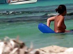 Topless teens having fun in the water