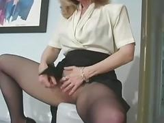 Solo girl fingers pussy through pantyhose