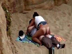 Chubby girl rides boyfriends cock in beach