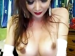 Incredible brunette tranny shows her ass and her tits