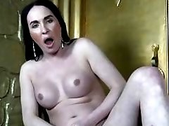 Adventurous Russian shemale with hardcore make-up strokes her fat cock