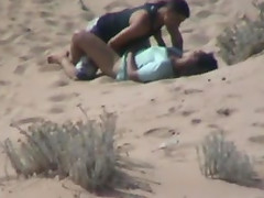 Amateur couple banging on a beach get caught on a voyeur's cam