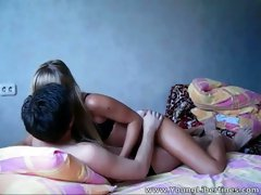 Charming blonde rides her lover's cock in cowgirl position