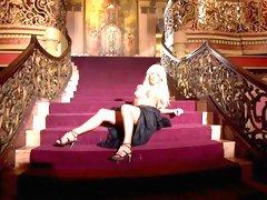 Elegant blonde walks through expensive house