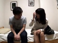 Adorable Oriental teen works her lips and her cunt on a dick