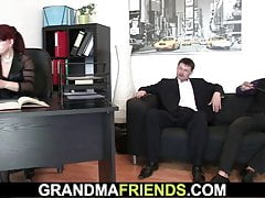 Business woman spreads legs for two guys