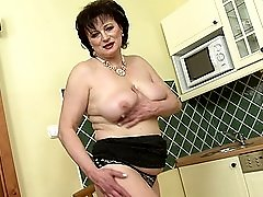 Short haired brunette MILF Dalia masturbates in the kitchen
