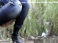 Tight pants blonde pissing in wild