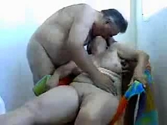 Busty amateur granny has her husband fingering her snatch