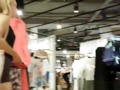 Blonde girl in clothes store