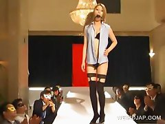 Asian models posing on catwalk